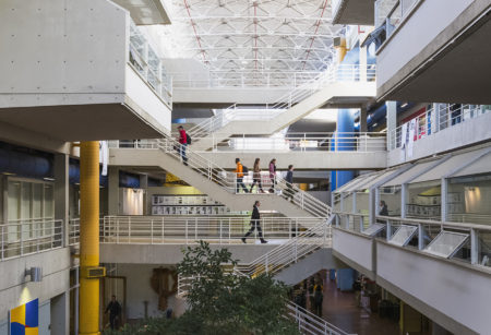 An interior shot showing the stairs and walkways crossing the Art + Architecture Building's atrium