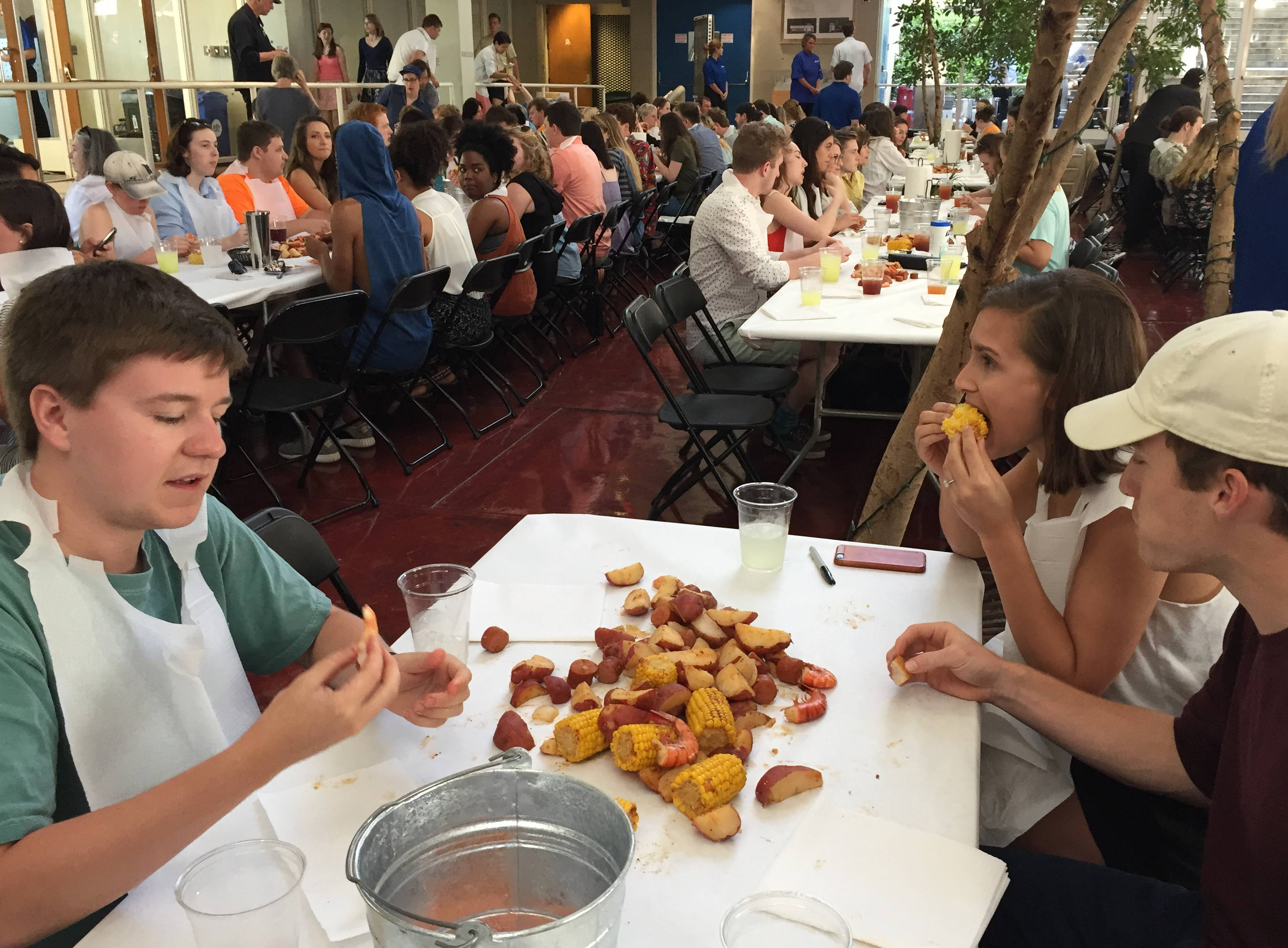 Students enjoying shrimp boil in the Art + Architecture Building