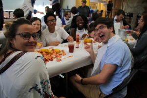 students eating and smiling at Brag + Boil 2018
