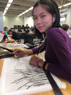 Female camper in studio with drawing